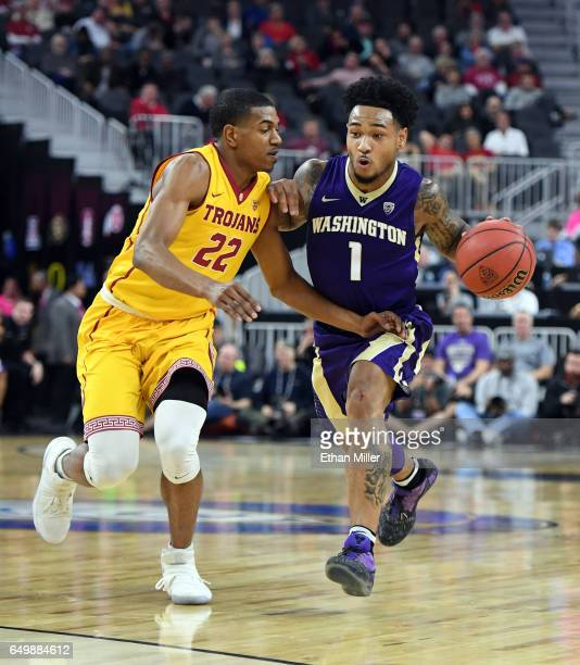David Crisp of the Washington Huskies drives against De'Anthony Melton of the USC Trojans during a firstround game of the Pac12 Basketball Tournament...