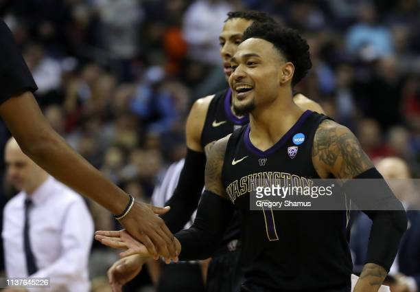 David Crisp of the Washington Huskies smiles as they take on the Utah State Aggies during the first half of the game in the first round of the 2019...