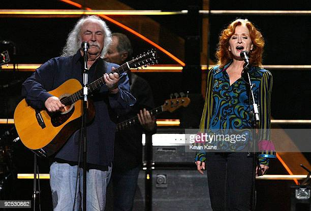 David Crosby of Crobsy Stills and Nash with Bonnie Raitt perform onstage at the 25th Anniversary Rock Roll Hall of Fame Concert at Madison Square...