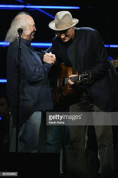 David Crosby of Crobsy Stills and Nash with James Taylor perform onstage at the 25th Anniversary Rock Roll Hall of Fame Concert at Madison Square...