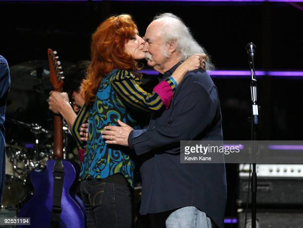 David Crosby of Crosby Stills and Nash with Bonnie Raitt onstage at the 25th Anniversary Rock Roll Hall of Fame Concert at Madison Square Garden on...