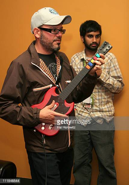 David Cross playing 'Guitar Hero' and Aziz Ansari during Blender House Party at SXSW Day 3 at Blender House in Austin Texas United States