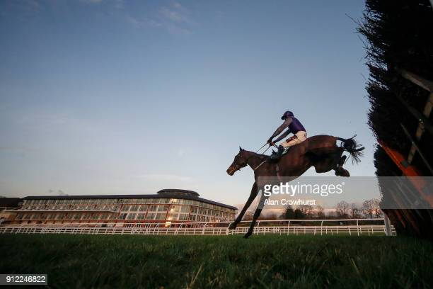 David Crosse riding Stolberg clear the last in fron of the hotel to win The Premier League Betting At 188Bet Handicap Hurdle at Lingfield Park...