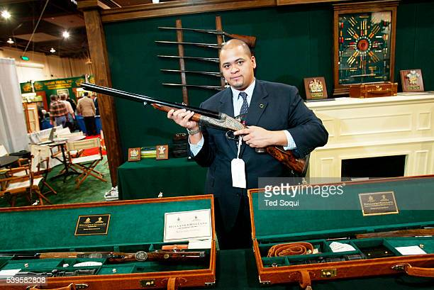 David Cruz of Holland and Holland Arms holding a $369K hunting rifle model Royal Delux 700 Nitro Express Made in London The Safari Hunters Club...