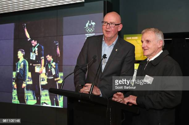 David Culbert and Adrian Powell talk on stage during a posthumous Order of Merit presentation to the family of Olympic silver medallist Peter Norman...