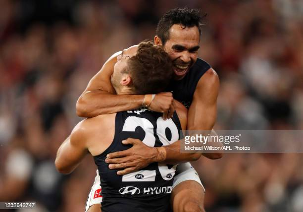 David Cuningham of the Blues and Eddie Betts of the Blues celebrate during the 2021 AFL Round 07 match between the Essendon Bombers and the Carlton...