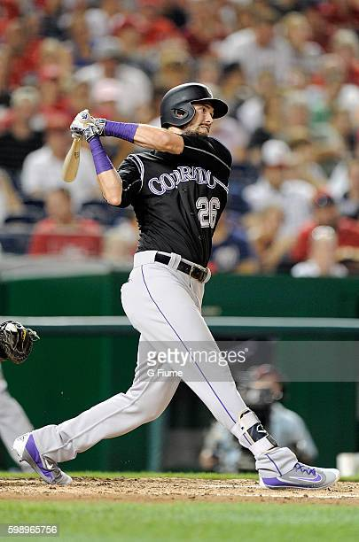 David Dahl of the Colorado Rockies bats against the Washington Nationals at Nationals Park on August 26 2016 in Washington DC