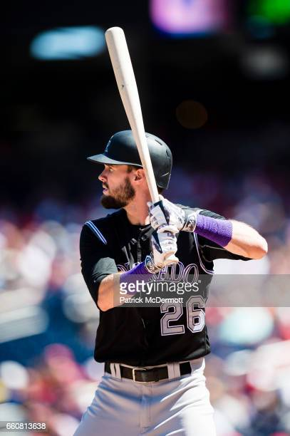 David Dahl of the Colorado Rockies bats against the Washington Nationals in the first inning during a MLB baseball game at Nationals Park on August...