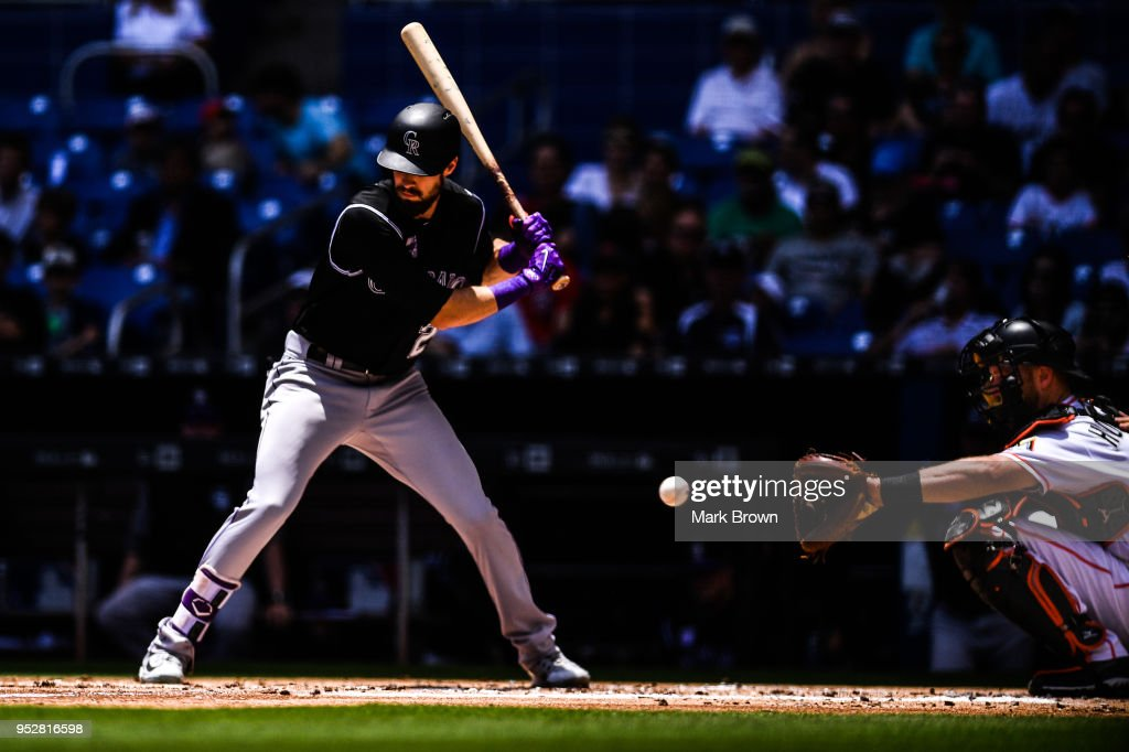 David Dahl #26 of the Colorado Rockies freezes during a pitch from Caleb Smith #31 of the Miami Marlins in the second inning during the game between the Miami Marlins and the Colorado Rockies at Marlins Park on April 29, 2018 in Miami, Florida.