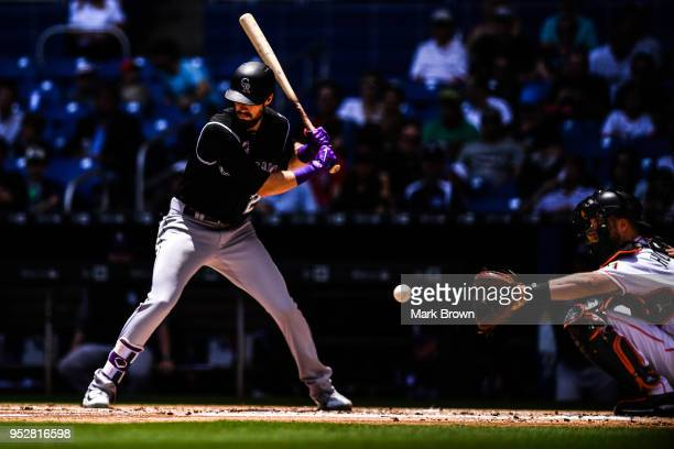 David Dahl of the Colorado Rockies freezes during a pitch from Caleb Smith of the Miami Marlins in the second inning during the game between the...