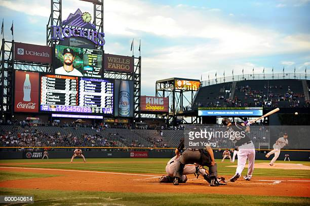 David Dahl of the Colorado Rockies hits a double in the first inning against the San Francisco Giants at Coors Field on September 7 2016 in Denver...