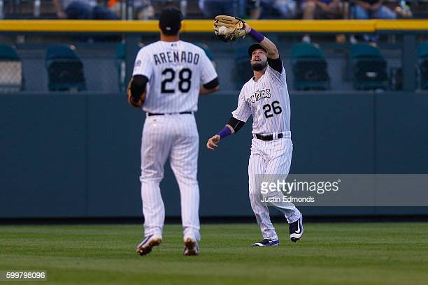 David Dahl of the Colorado Rockies makes a catch in shallow left field as Nolan Arenado looks on during the first inning against the San Francisco...