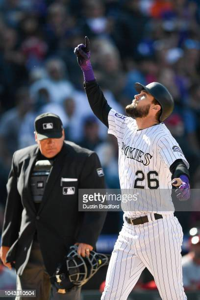 David Dahl of the Colorado Rockies points to the sky and celebrates after hitting a fifth inning threerun homerun against the Washington Nationals at...