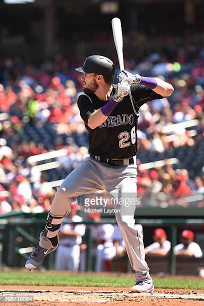 David Dahl of the Colorado Rockies prepares for a pitch during a baseball game against the Washington Nationals at Nationals Park on August 27 2016...