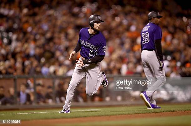 David Dahl of the Colorado Rockies runs home to score on a hit by Gerardo Parra of the Colorado Rockies in seventh inning at ATT Park on September 28...