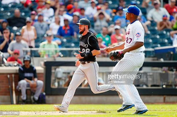 David Dahl of the Colorado Rockies scores a run in the ninth inning after a wild pitch from Jeurys Familia of the New York Mets at Citi Field on July...