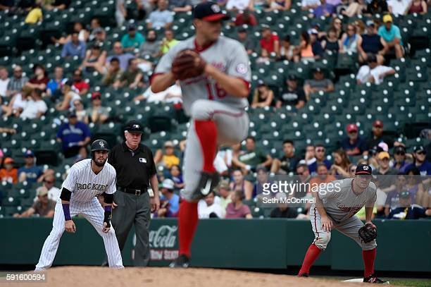 David Dahl of the Colorado Rockies takes a lead off first as Matt Belisle of the Washington Nationals delivers a pitch during the fifth inning at...