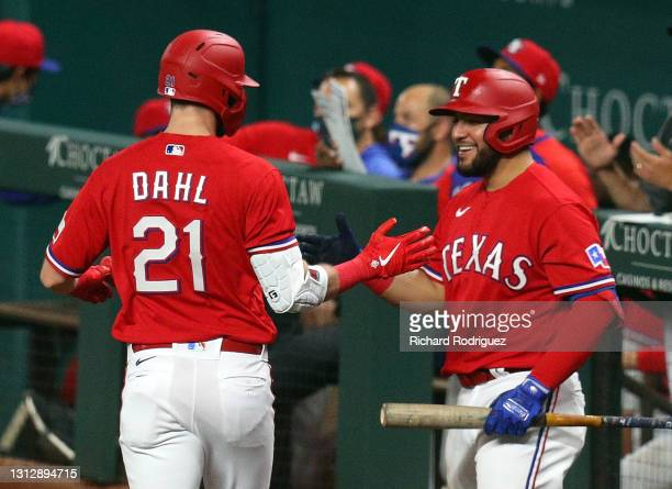David Dahl of the Texas Rangers celebrates his solo home run in the fifth inning with Jose Trevino against the Baltimore Orioles at Globe Life Field...