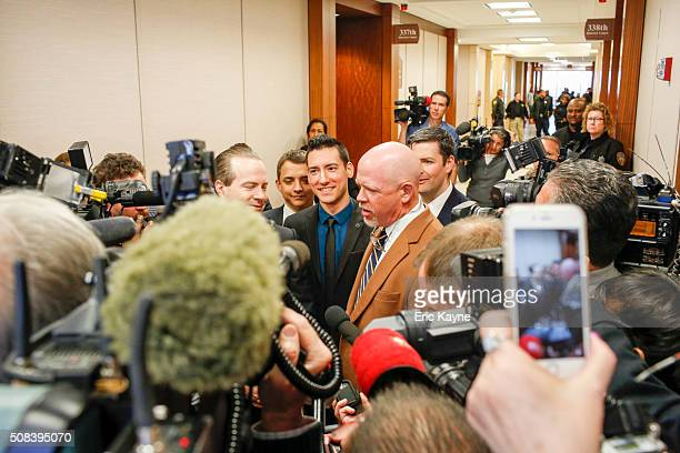 David Daleiden , a defendant in an indictment stemming from a Planned Parenthood video he helped produce, stands with attorneys Jared Woodfill and...