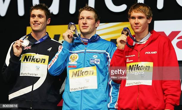 David Davies of United Kingdom celebrates the silver medal Nikita Lobintsev of Russian Federation the gold medal and Mateusz Sawrymowicz of Poland...
