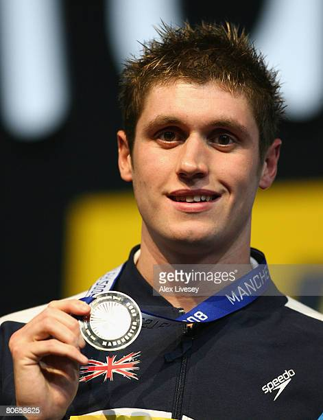 David Davies of United Kingdom receives the silver medal in the Men's 1500m Freestyle Final during the ninth FINA World Swimming Championships at the...