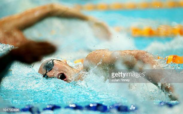 David Davies of Wales competes in the Men's 400m Freestyle Heat 2 at the Dr SP Mukherjee Swimming Complex during day one of the Delhi 2010...