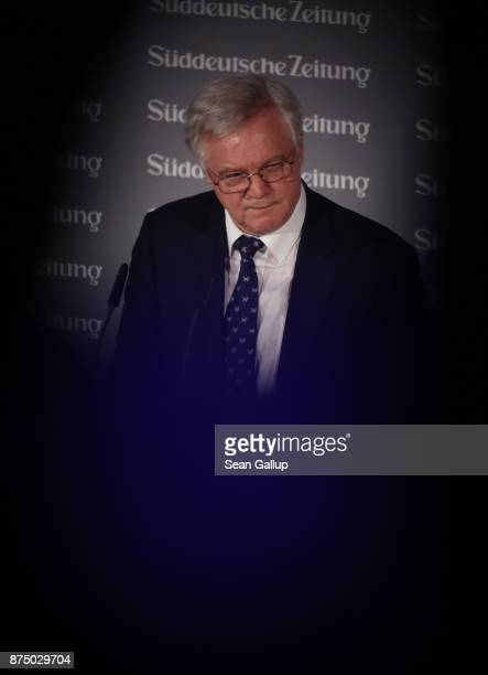 David Davis British Secretary of State for Exiting the European Union is seen between guests as he speaks at the Sueddeutsche Zeitung Economic Summit...