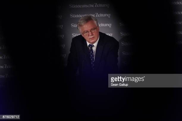 David Davis British Secretary of State for Exiting the European Union is seen between the limbs of a guest as he speaks at the Sueddeutsche Zeitung...