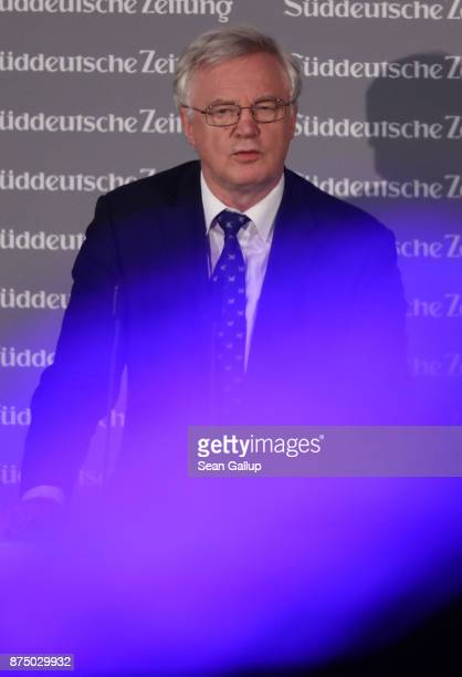 David Davis British Secretary of State for Exiting the European Union speaks behind an LED coloured light at the Sueddeutsche Zeitung Economic Summit...