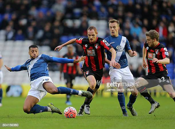 David Davis of Birmingham City and Shaun MacDonald of Bournemouth as Andrew Shinnie of Birmingham City watches on during The Emirates FA Cup match...