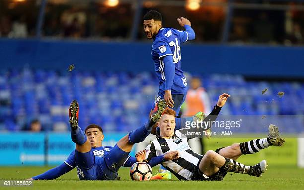 David Davis of Birmingham City watches on as Che Adams of Birmingham City and Jack Colback of Newcastle United challenge for the ball during the...