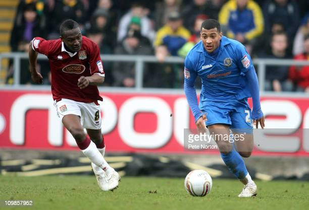 David Davis of Shrewsbury moves away with the ball as Abdul Osman of Northampton Town looks on during the npower League Two match between Northampton...