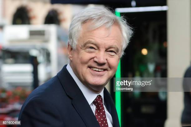 David Davis UK exiting the European Union secretary gets into his car inbetween doing media interviews in London UK on Tuesday Aug 15 2017 The UK...