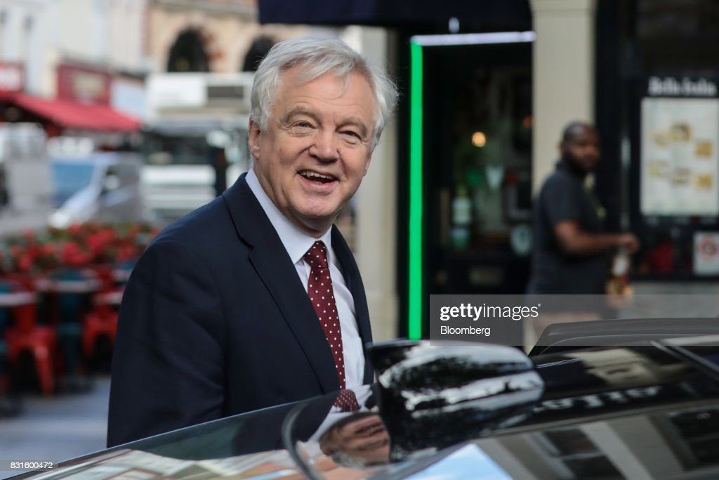 David Davis, U.K. exiting the European Union (EU) secretary, gets into his car in-between doing media interviews in London, U.K., on Tuesday, Aug. 15, 2017. The U.K. government said it wants to maintain tariff-free, bureaucracy-light trade with the European Union for a period of up to two years after Brexit, a proposalcheered by British businesses but which is likely to raise eyebrows on the continent. Photographer: Simon Dawson/Bloomberg via Getty Images