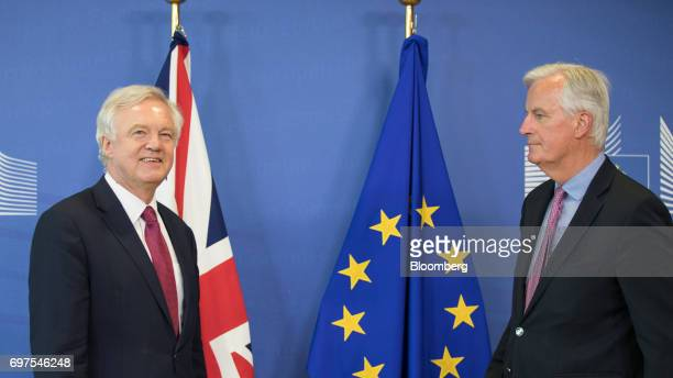David Davis UK exiting the European Union secretary left and Michel Barnier chief negotiator for the European Union look on ahead of the start of...