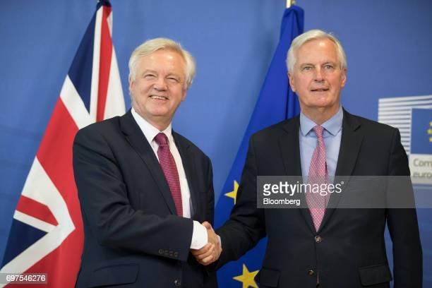 David Davis UK exiting the European Union secretary left and Michel Barnier chief negotiator for the European Union shake hands ahead of the start of...