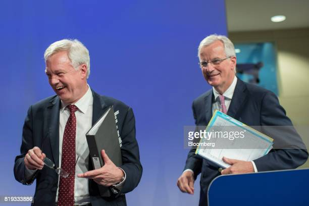 David Davis UK exiting the European Union secretary left and Michel Barnier chief negotiator for the European Union react as they depart a news...