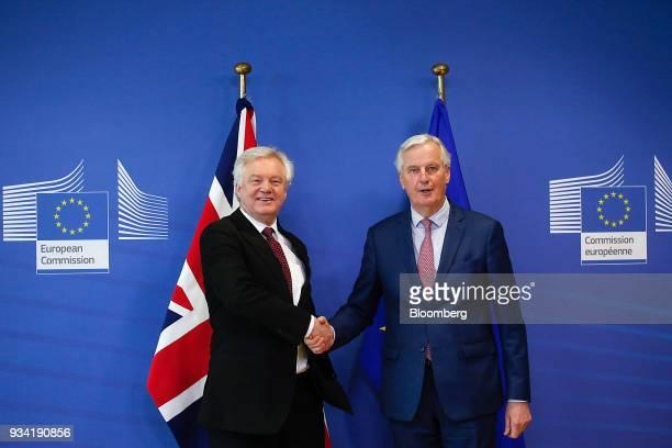 David Davis UK exiting the European Union secretary left and Michel Barnier chief negotiator for the European Union pose for a photograph ahead of...
