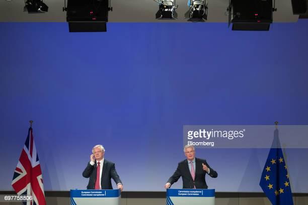 David Davis UK exiting the European Union secretary left listens as Michel Barnier chief negotiator for the European Union speaks during a news...