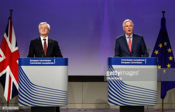 David Davis UK exiting the European Union secretary left looks on as Michel Barnier chief negotiator for the European Union speaks during a news...