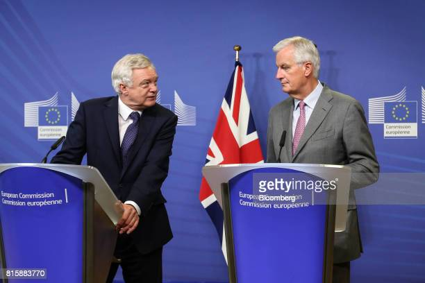 David Davis UK exiting the European Union secretary left looks towards Michel Barnier chief negotiator for the European Union during a news...