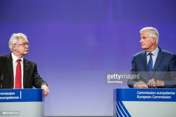 David Davis UK exiting the European Union secretary left looks towards Michel Barnier chief negotiator for the European Union during a news...
