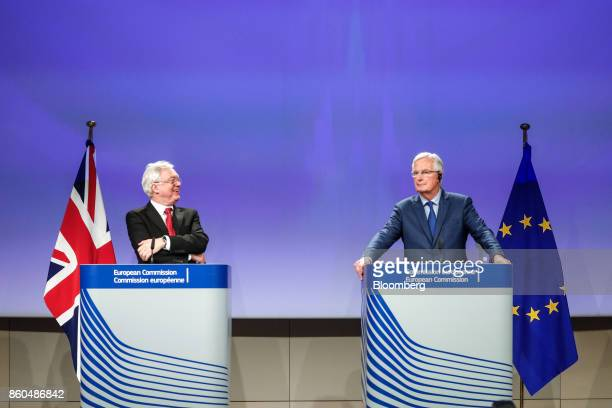 David Davis UK exiting the European Union secretary left reacts as Michel Barnier chief negotiator for the European Union looks on during a news...