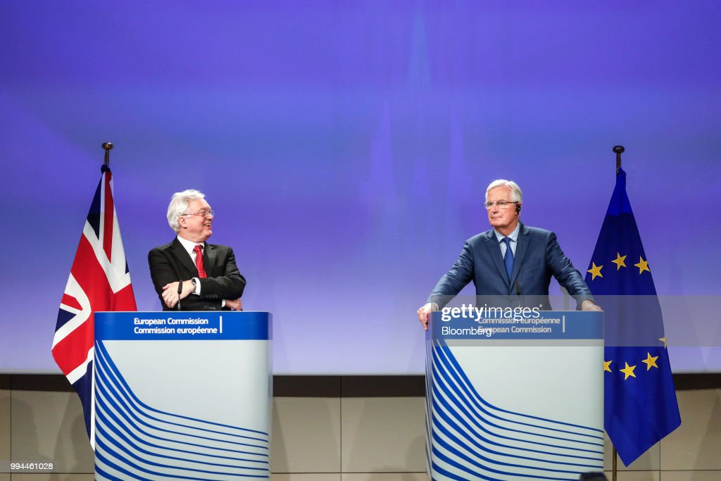 David Davis, U.K. exiting the European Union (EU) secretary, left, reacts as Michel Barnier, chief negotiator for the European Union (EU), looks on during a news conference following Brexit negotiations in Brussels, Belgium, on Thursday, Oct. 12, 2017. U.K. Prime Minister Theresa May was plunged into a crisis after Brexit Secretary David Davis and his deputy resigned over her plans to keep close ties to the European Union after the divorce. The man who is going to inherit one of the toughest jobs in the U.K. -- negotiating Brexit -- is a 44-year-old former Foreign Office lawyer who entered Parliament in 2010: Dominic Raab. Our editors select the best archive images of Raab and Davis. Photographer: Dario Pignatelli/Bloomberg via Getty Images