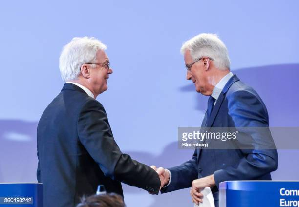 David Davis UK exiting the European Union secretary left shakes hands with Michel Barnier chief negotiator for the European Union during a news...