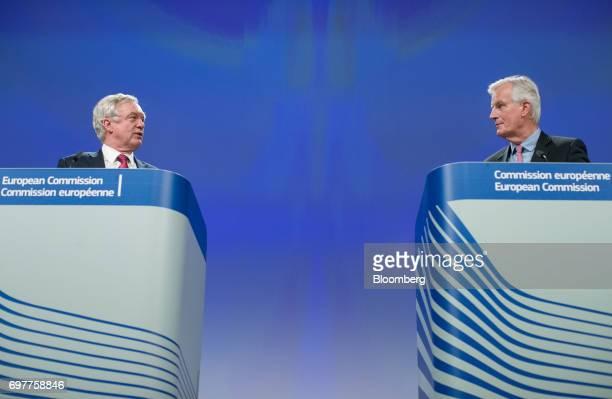 David Davis UK exiting the European Union secretary left speaks as Michel Barnier chief negotiator for the European Union listens during a news...