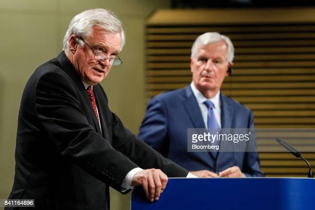 David Davis UK exiting the European Union secretary left speaks as Michel Barnier chief negotiator for the European Union speaks during a news...