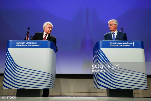 David Davis UK exiting the European Union secretary left speaks as Michel Barnier chief negotiator for the European Union looks on during a news...
