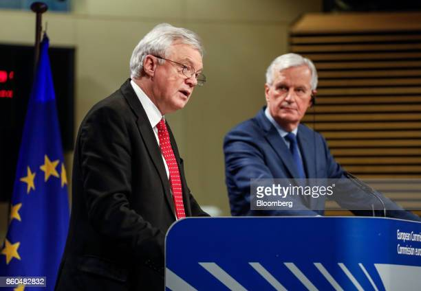 David Davis UK exiting the European Union secretary left speaks as Michel Barnier chief negotiator for the European Union looks on during a news...