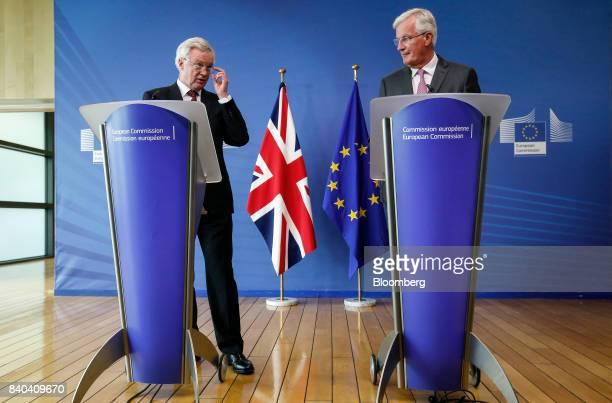 David Davis UK exiting the European Union secretary left speaks while Michel Barnier chief negotiator for the European Union listens during a news...